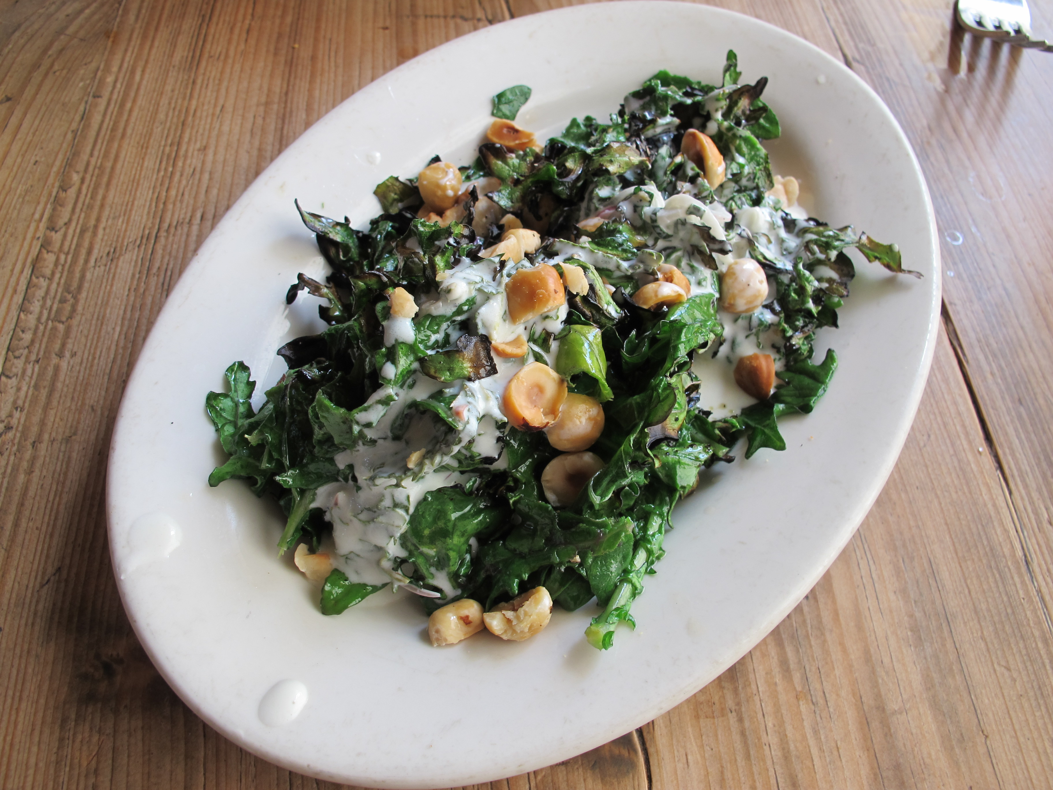 Kale with yoghurt and hazelnuts at Gjelina in Venice