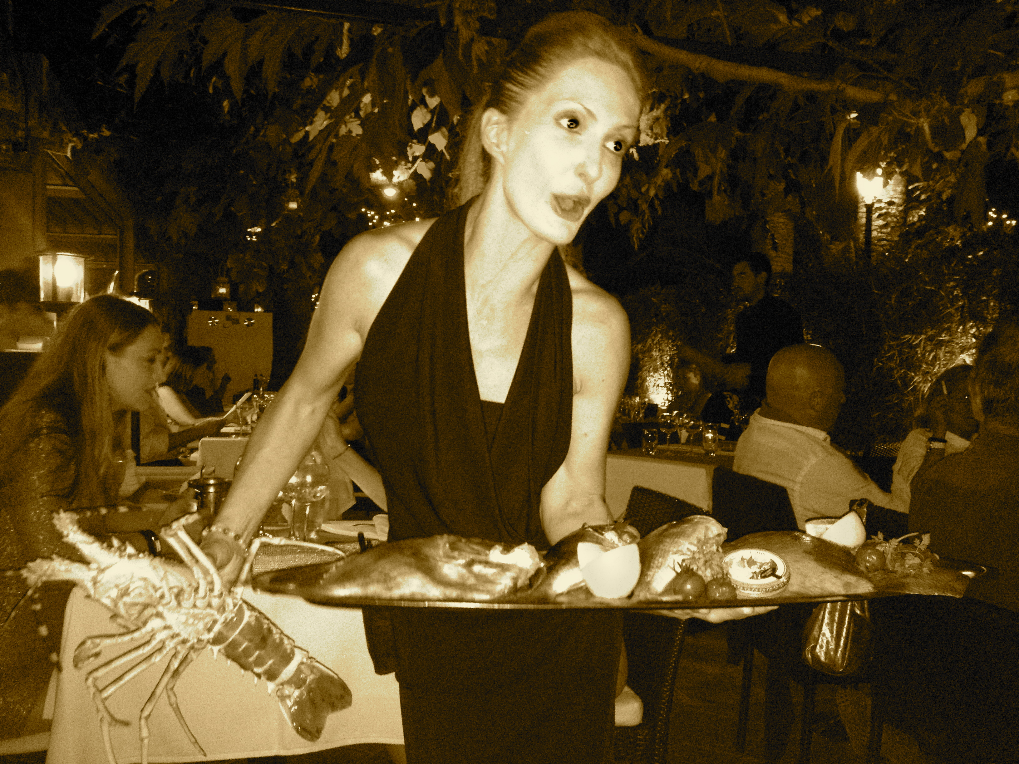 Waitress offering daily fish & lobster
