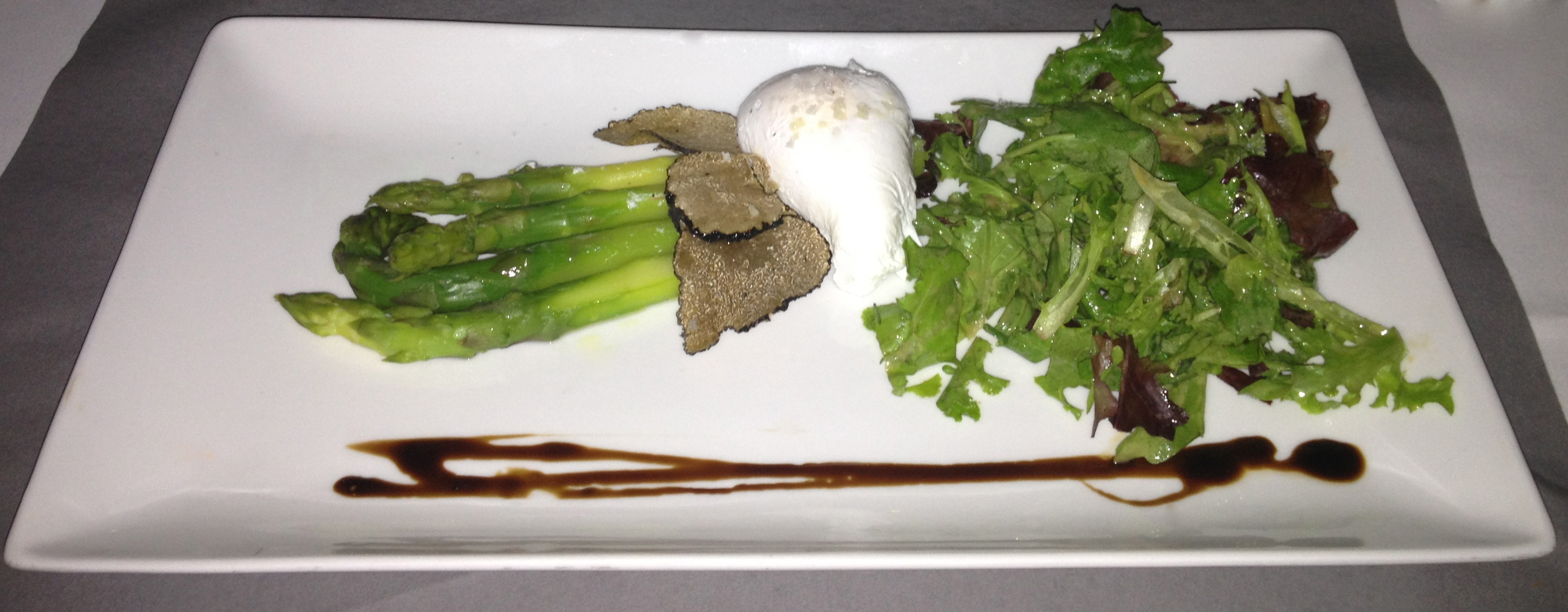 Asparagus with poached egg and truffles
