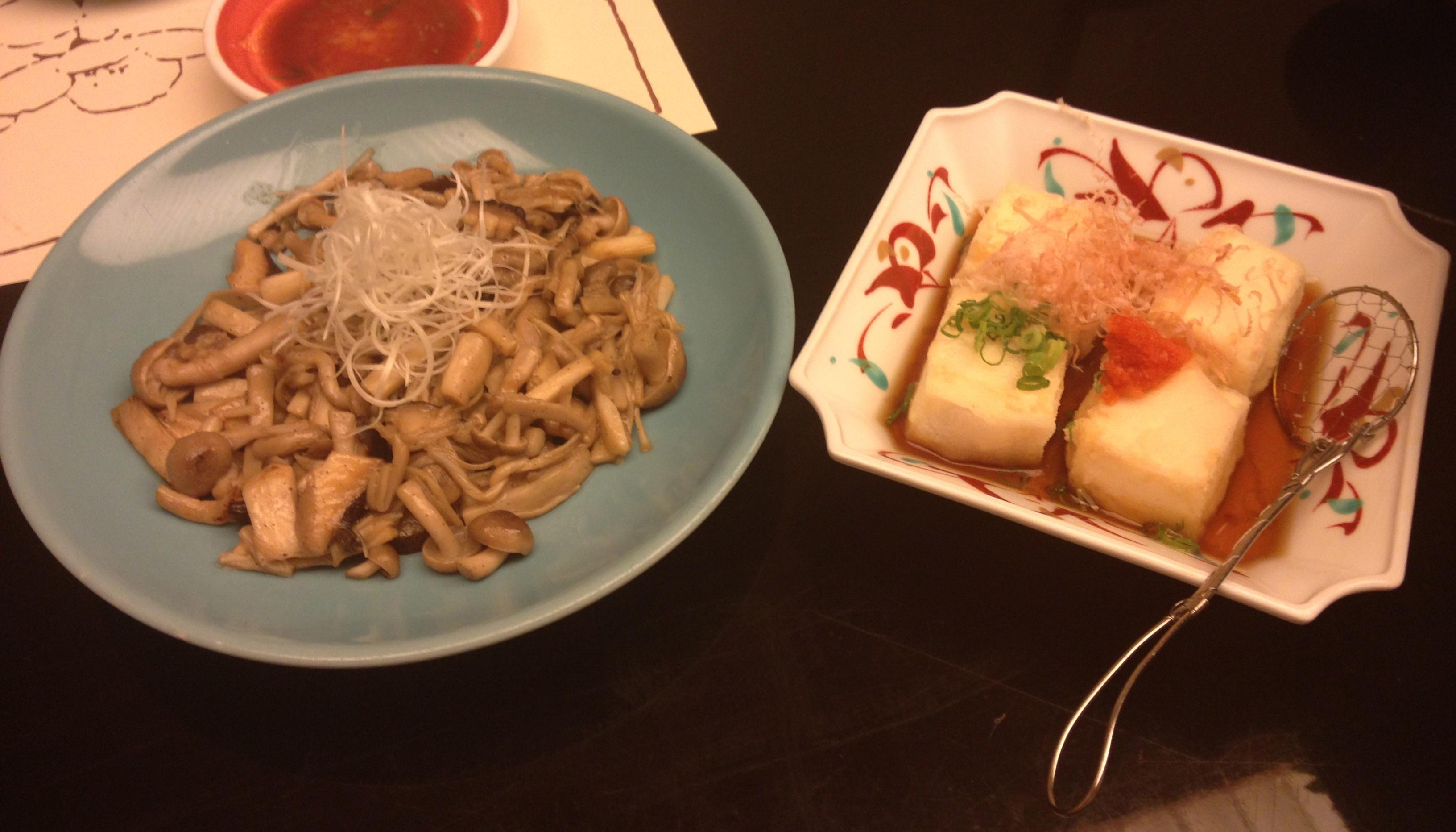 Simmering mushrooms and deep fried tofu