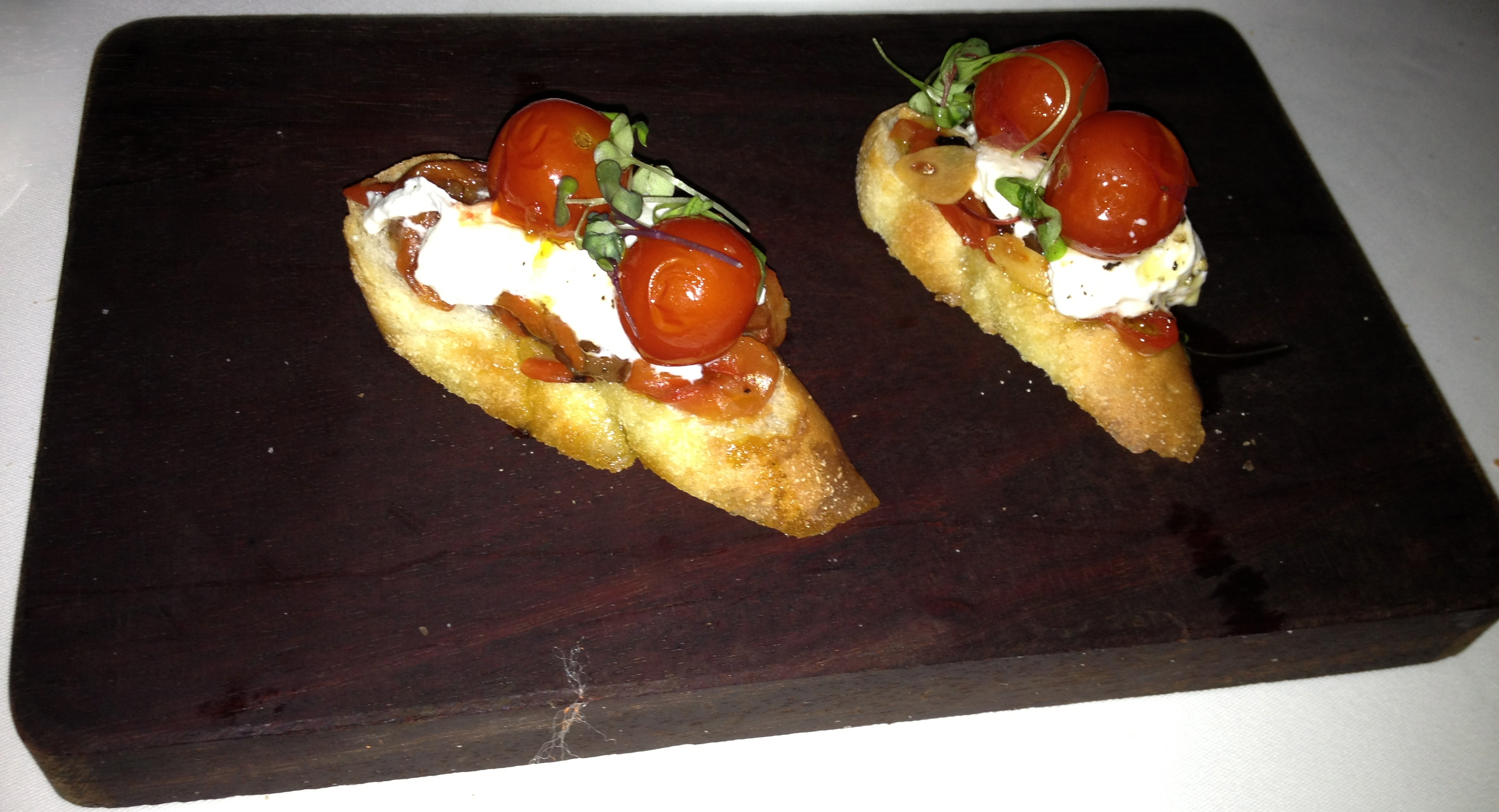 Cherry tomatoes and burrata bruschetta