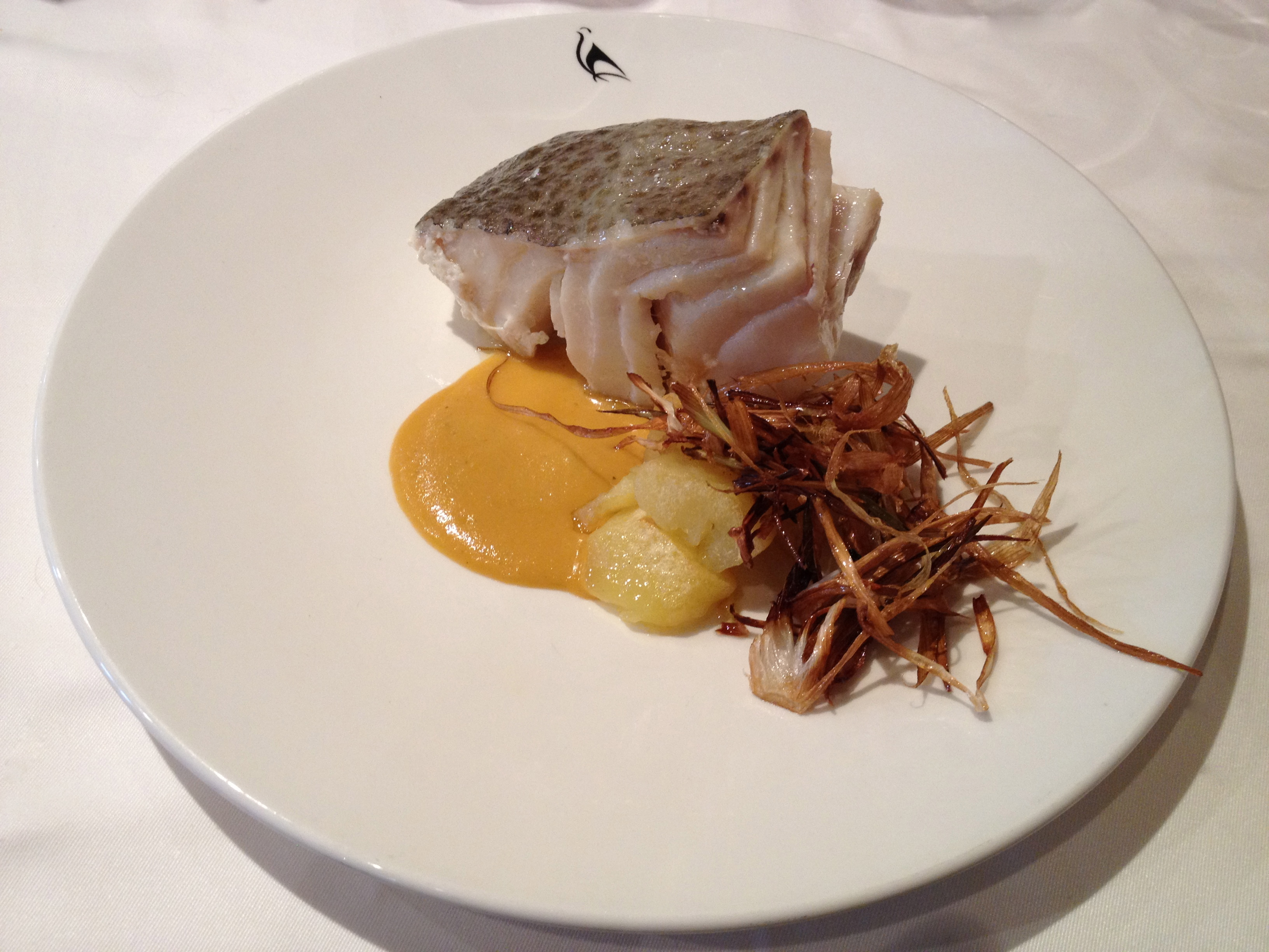 Bacalao (turbot) with mild curry sauce, potatoes and crispy vegetables.