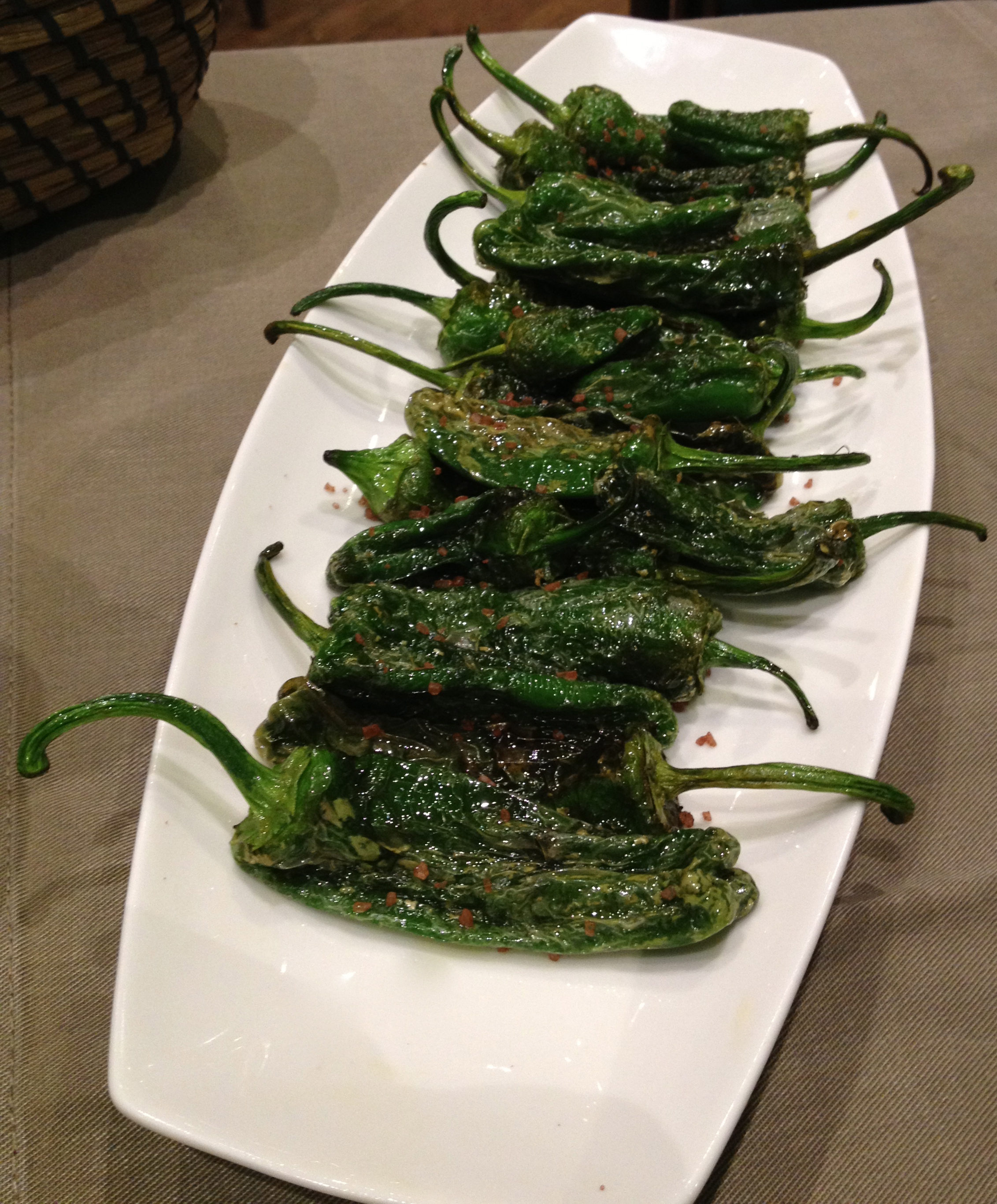 Fried green peppers with salt