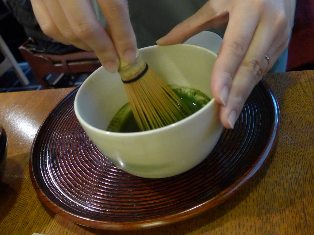 Whisking matcha tea at Ippodo