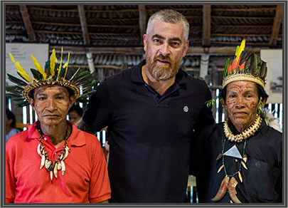 Chef Alex Atala with Amazonian tribesmen