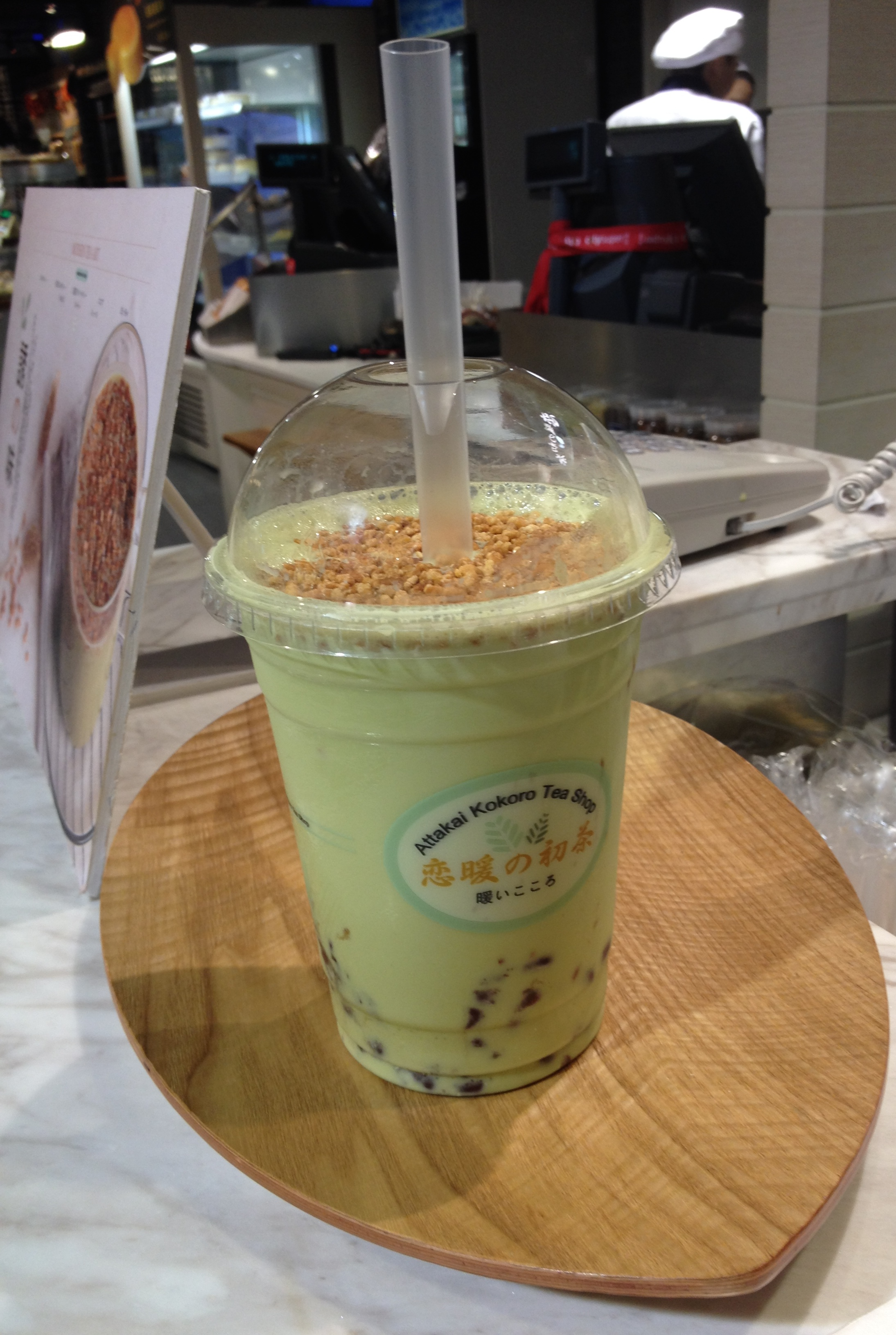 Matcha bubble tea with wafer topping