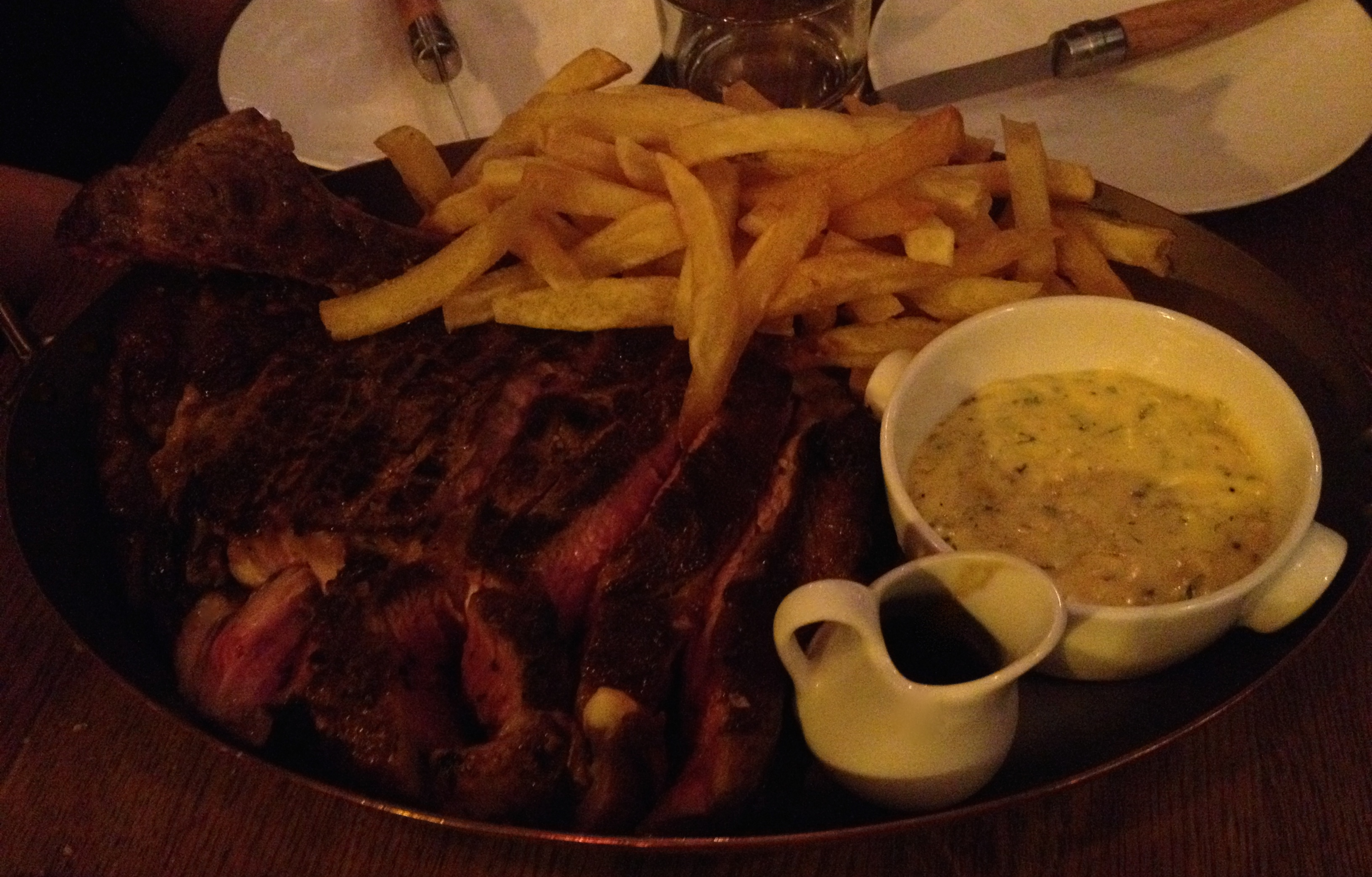 Beef steak with french fries and homemade Bearnaise sauce