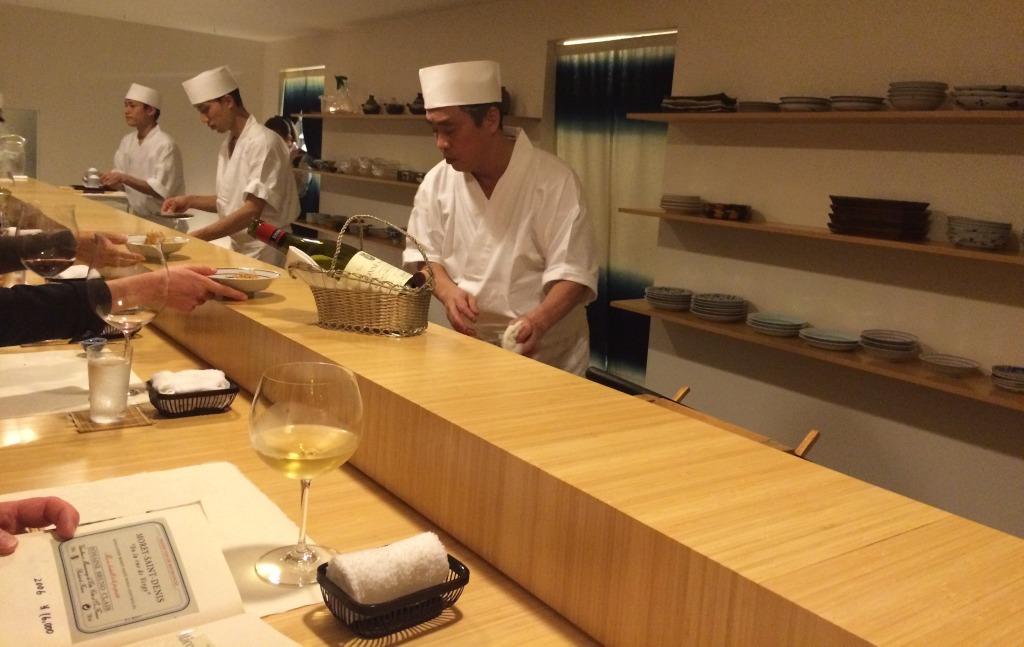 The chef Hiroyuki Kanda behind the counter
